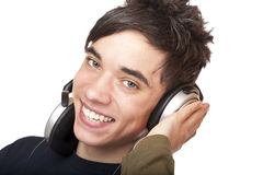 Teenager with headphones listens to mp3 dusic Stock Photos