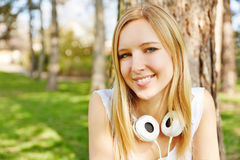 Teenager with headphones in a park Royalty Free Stock Images