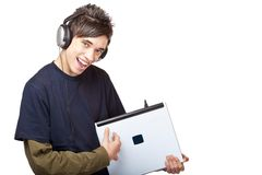 Teenager with headphones plays guitar on laptop Stock Images