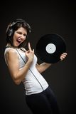 Teenager with headphones and record in hands Stock Photos