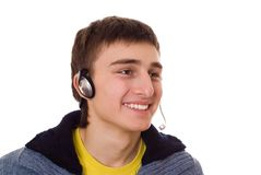 Teenager with headphones on white Royalty Free Stock Photos