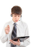 Teenager with Headset and Clipboard Royalty Free Stock Photography