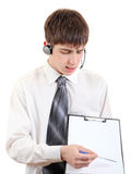 Teenager with Headset and Clipboard Royalty Free Stock Photos