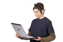 Teenager with headset downloads internet music. Teenager with headset makes internet mp3 music download at computer. Isolated on white background Stock Photos