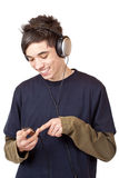 Teenager with headset use mp3 music player. Isolated on white background Stock Images