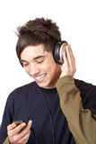 Teenager with headset use mp3 music player Stock Photos