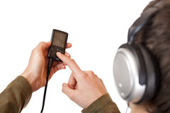 Teenager with headset use mp3 music player Royalty Free Stock Photography