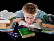 The teenager. Was tired of homeworks. The teenager with a heap of textbooks. Was tired of homeworks Royalty Free Stock Photo
