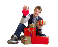 Teenager with heart and gifts isolated Royalty Free Stock Image