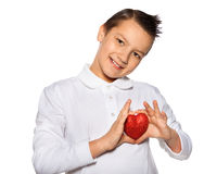Teenager with a heart in hands smiles Stock Photo