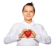 Teenager with a heart in hands smiles Stock Image