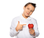Teenager with a heart in hands smiles Royalty Free Stock Photography