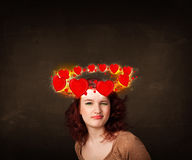 Teenager with heart illustrations circleing around her head Royalty Free Stock Image