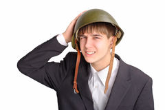 Teenager in helmet. The teenager in a military helmet stock images