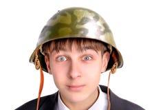 Teenager in helmet. The teenager in a military helmet Royalty Free Stock Photo