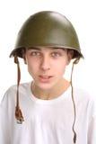 Teenager in helmet. The teenager in a military helmet Stock Photos