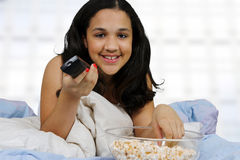 Teenager On Her Bed Royalty Free Stock Photos