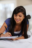 Teenager On Her Bed Stock Images
