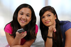 Teenager On Her Bed With Friend Stock Photo