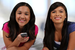 Teenager On Her Bed With Friend Royalty Free Stock Photography