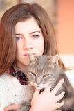 Teenager with her cat Royalty Free Stock Images