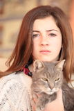 Teenager with her cat Stock Images