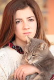 Teenager with her cat Stock Photo
