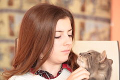 Teenager with her cat Royalty Free Stock Photography