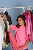 Teenager In Her Closet Stock Photo