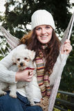 Teenager and her dog. A portrait of a beautiful teenager outdoor relaxing with her dog Royalty Free Stock Photography