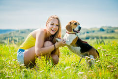 Teenager with her dog Stock Image