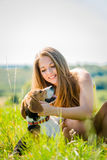 Teenager with her dog Stock Images