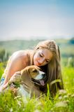 Teenager with her dog Royalty Free Stock Photos