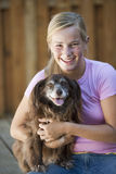 Teenager and her dog posing for picture Stock Photo