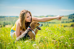 Teenager with her dog Royalty Free Stock Photo