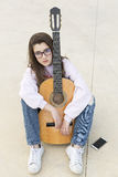Teenager with her guitar Stock Photography