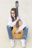 Teenager with her guitar Stock Images