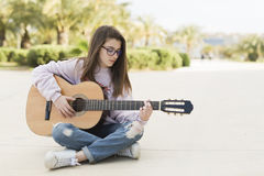 Teenager with her guitar Stock Photo
