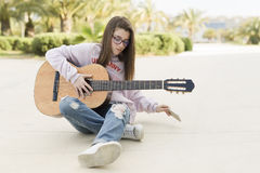 Teenager with her guitar Royalty Free Stock Images