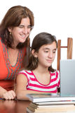 Teenager and her mom working on a laptop computer Stock Images