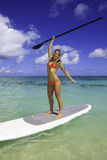 Teenager on her paddleboard Royalty Free Stock Image