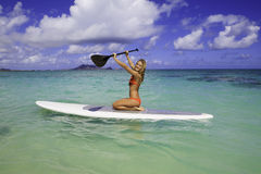 Teenager on her paddleboard Stock Images