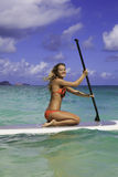 Teenager on her paddleboard Stock Photos