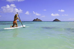 Teenager on her paddleboard Stock Image