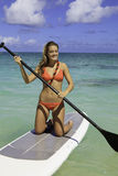 Teenager on her paddleboard Royalty Free Stock Photo