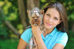 Teenager with her puppy dog in the park Royalty Free Stock Photo