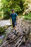 Teenager hiker crossing the river Stock Photography