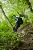 Teenager hiker on a mountain trail Royalty Free Stock Photos