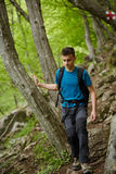 Teenager hiker on a mountain trail Royalty Free Stock Image