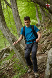 Teenager hiker on a mountain trail Royalty Free Stock Images